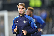 Luton Town midfielder Andrew Shinnie (11) warms up prior to the EFL Sky Bet Championship match between Fulham and Luton Town at Craven Cottage, London, England on 23 October 2019.