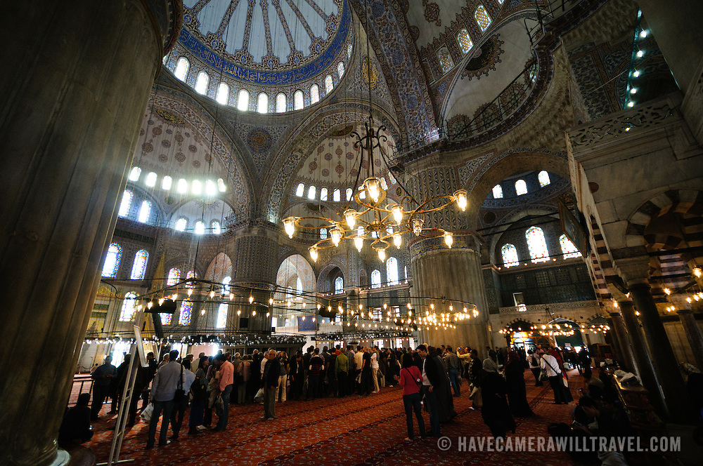 Tourists crowd Istanbul's famous Blue Mosque. Sultan Ahmed Mosque (Turkish: Sultanahmet Camii) known popularly as the Blue Mosque is a Muslim (Sunni) Mosque in the center of Istanbul's old town district of Sultanahmet. It was commissioned by Sultan Ahmed I and completed in 1616,