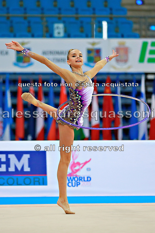"""Averina Dina during hoop routine at the International Tournament of rhythmic gymnastics """"Città di Pesaro"""", 10 April, 2015. Dina was born on August 13, 1998 in Zavolzhye, Russia. Dina has a twin sister ,Arina is also herself a great gymnast member of the Russian National Team.<br /> This tournament dedicated to the youngest athletes is at the same time of the World Cup."""