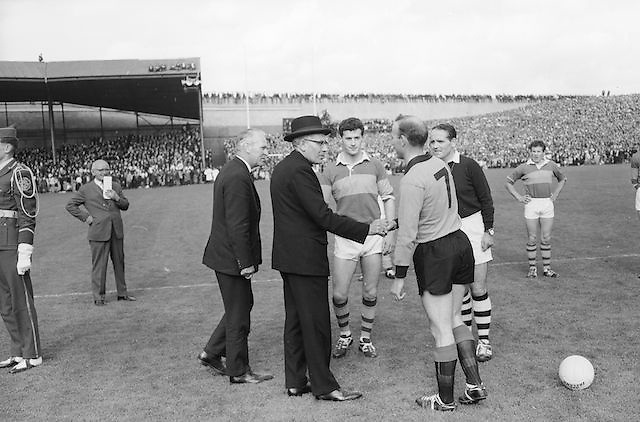 Captains shaking hands with referees and officials before the All Ireland Senior Gaelic Football Final Kerry v Down in Croke Park on the 22nd September 1968. Down 2-12 Kerry 1-13.