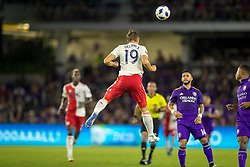 August 4, 2018 - Orlando, FL, U.S. - ORLANDO, FL - AUGUST 04: New England Revolution defender Antonio Delamea Mlinar (19) goes up for a header during the soccer match between the Orlando City Lions and the New England Revolution on August 4, 2018 at Orlando City Stadium in Orlando FL. (Photo by Joe Petro/Icon Sportswire) (Credit Image: © Joe Petro/Icon SMI via ZUMA Press)