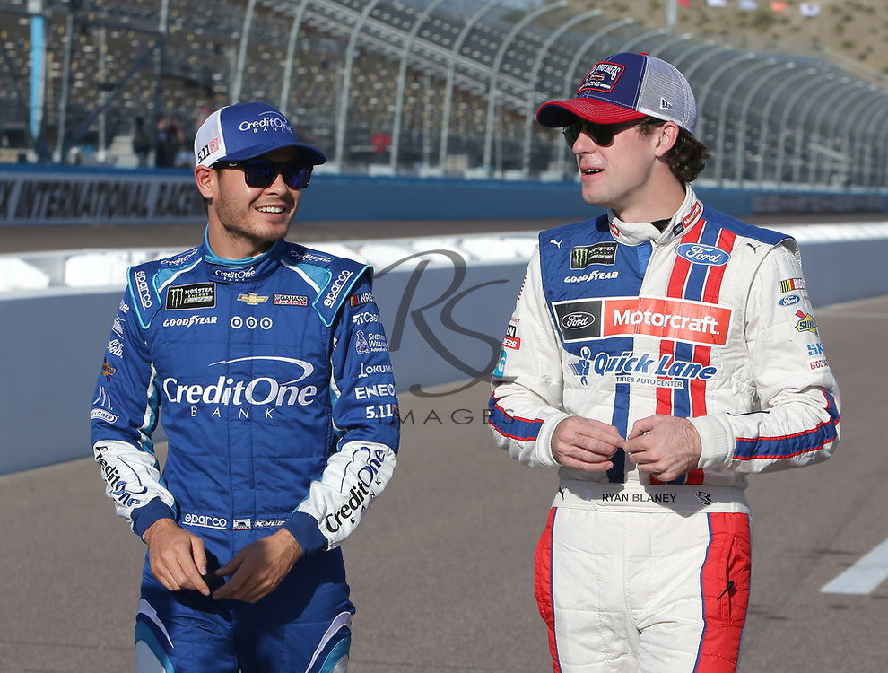 Kyle Larson and Ryan Blaney before qualifying for Sunday's NASCAR Cup Series auto race on Friday, March 17, 2017, in Avondale, Ariz.  (AP Photo/Rick Scuteri)