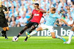 Manchester United's Danny Welbeck is challenged by Manchester City's Pablo Zabaleta - Photo mandatory by-line: Dougie Allward/JMP - Tel: Mobile: 07966 386802 22/09/2013 - SPORT - FOOTBALL - City of Manchester Stadium - Manchester - Manchester City V Manchester United - Barclays Premier League