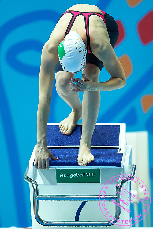 Ashgabat, Turkmenistan - 2017 September 24: Keyik Weliyewa competes in Women's 50m Butterfly Heat 2 Short Course Swimming competition during 2017 Ashgabat 5th Asian Indoor & Martial Arts Games at Aquatics Centre (AQC) at Ashgabat Olympic Complex on September 24, 2017 in Ashgabat, Turkmenistan.<br /> <br /> Photo by © Adam Nurkiewicz / Laurel Photo Services