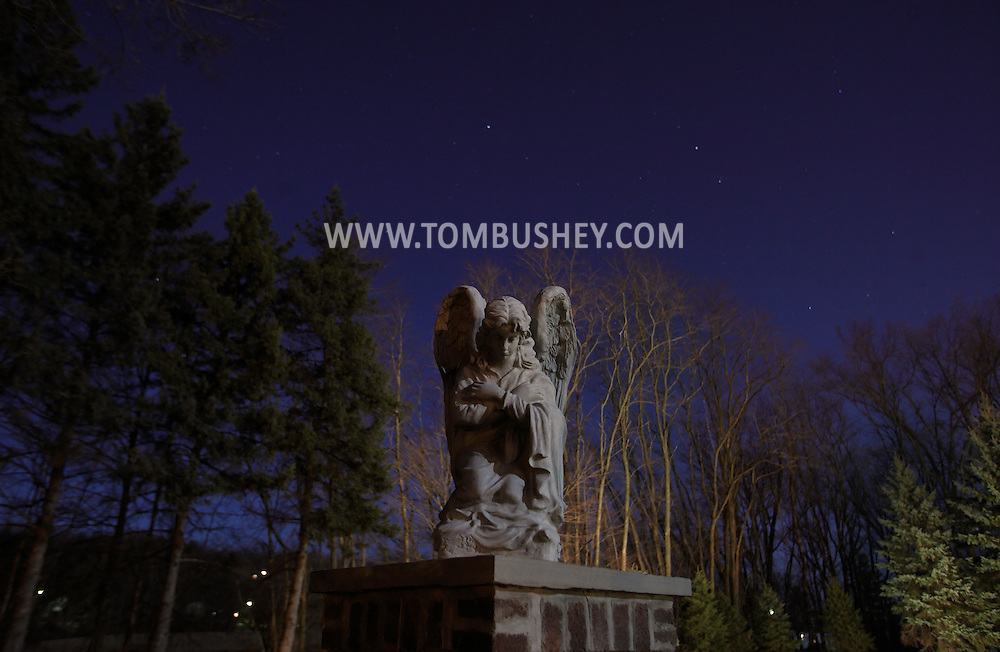 Middletown, New York - An angel in the moonlight outside the cemetery at the National Shrine of Our Lady of Mount Carmel on March 19, 2011