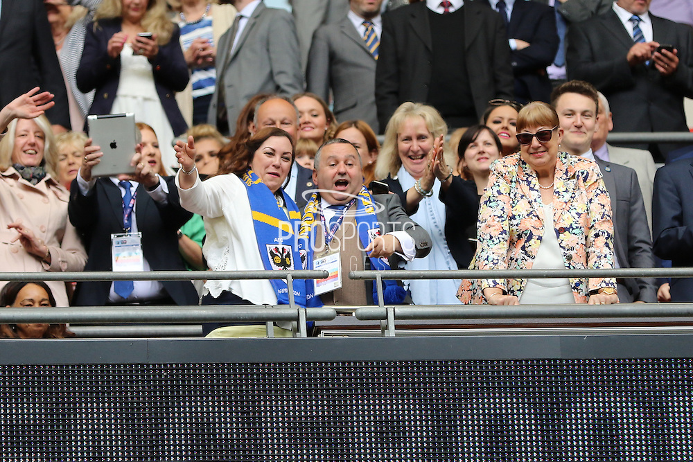 AFC Wimbledon directors celebrate promotion to League One, after beating Plymouth Argyle Football Club 2-0 during the Sky Bet League 2 play off final match between AFC Wimbledon and Plymouth Argyle at Wembley Stadium, London, England on 30 May 2016. Photo by Stuart Butcher.