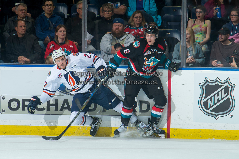 KELOWNA, CANADA - SEPTEMBER 22: Jack Cowell #8 of the Kelowna Rockets checks Nolan Kneen #27 of the Kamloops Blazers into the boards during first period on September 22, 2018 at Prospera Place in Kelowna, British Columbia, Canada.  (Photo by Marissa Baecker/Shoot the Breeze)  *** Local Caption ***