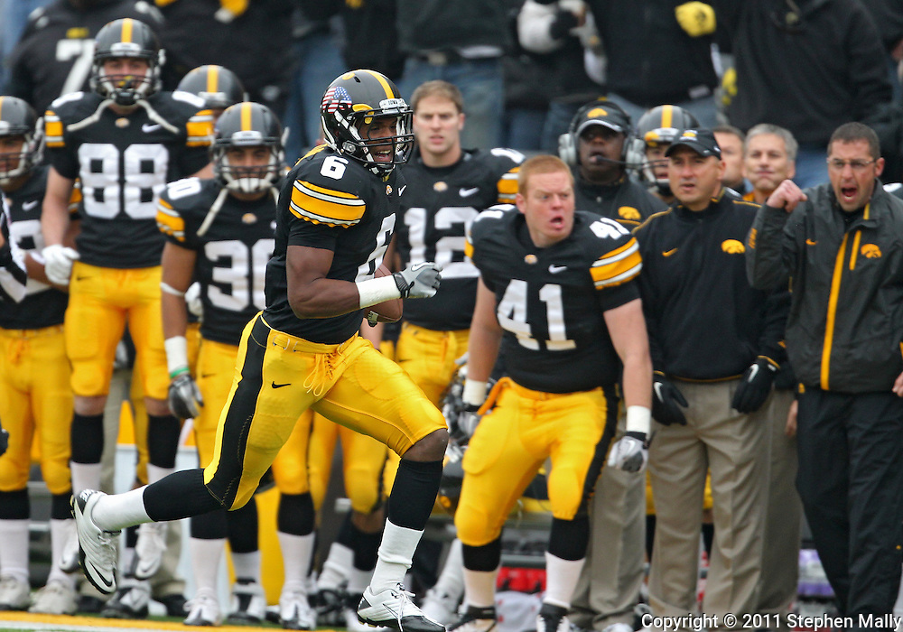 November 05, 2011: Iowa Hawkeyes wide receiver Keenan Davis (6) takes off down field after a catch during the first quarter of the NCAA football game between the Michigan Wolverines and the Iowa Hawkeyes at Kinnick Stadium in Iowa City, Iowa on Saturday, November 5, 2011. Iowa defeated Michigan 24-16.