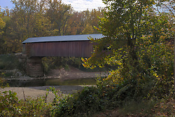 14 Oct 2011: Built in 1913 over Sugar Creek, the Cox Ford bridge is located on Cox Ford road and spans 176 feet. Rural Indiana, Near or in Parke County This image was produced in part utilizing High Dynamic Range (HDR) or panoramic stitching or other computer software manipulation processes. It should not be used editorially without being listed as an illustration or with a disclaimer. It may or may not be an accurate representation of the scene as originally photographed and the finished image is the creation of the photographer.