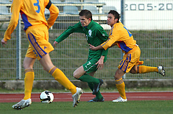 Josip Ilicic (7)  of Slovenia and Alexandru Vagner of Romania  during Friendly match between U-21 National teams of Slovenia and Romania, on February 11, 2009, in Nova Gorica, Slovenia. (Photo by Vid Ponikvar / Sportida)