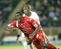 Photo: Marc Atkins.<br /> <br /> Milton Keynes Dons v Peterborough United. Coca Cola League 2. 06/10/2006.<br /> <br /> <br /> Trevor Benjamin (F) of Peterboro is fouled by Drissa Diallo of MK Dons.