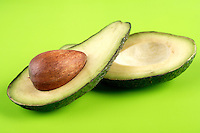 Avocado on green background - studio shot