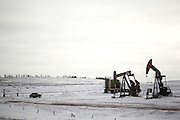 Oil pump jacks are seen along Interstate 94 in the Bakken Formation near Belfield, North Dakota in January 2017.<br /> <br /> The oil industry in North Dakota supports much of its economic stability and infrastructure. According to a recent study by Grand Forks firm AE2S Nexus, cities in North Dakota&rsquo;s oil-heavy Bakken Formation are expected to see a growth in population as oil prices recover. The population growth will require an expansion of city infrastructure and services to keep up with demands needed to provide for its residents.