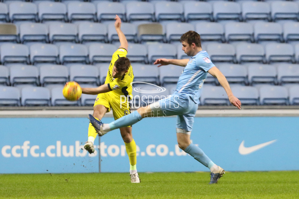 Kevin Dawson and Chris Stokes during the EFL Sky Bet League 2 match between Coventry City and Cheltenham Town at the Ricoh Arena, Coventry, England on 16 December 2017. Photo by Antony Thompson.