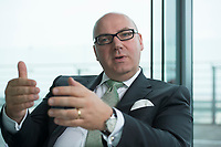 18 APR 2012, BERLIN/GERMANY:<br /> Prof. Dr.-Ing. Raimund Klinkner, Vorstandschef der Bundesvereinigung Logistik, BVL, waehrend einem Interview, Deutsche Bahn Tower<br /> IMAGE: 20120418-01-008