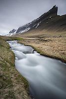 River in Lokinhamradalur valley. Mount Skeggi above. Lokinhamrar, Arnarfjörður, West fiords of Iceland.