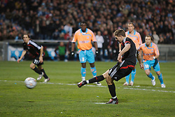 MARSEILLE, FRANCE - Tuesday, December 11, 2007: Liverpool's captain Steven Gerrard MBE scores from the rebound to his penalty kick against Olympique de Marseille during the final UEFA Champions League Group A match at the Stade Velodrome. (Photo by David Rawcliffe/Propaganda)