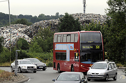 © Licensed to London News Pictures. 11/07/2014<br /> A view from near by Crittals Corner round about and the A20 flyover <br /> The Environment Agency has two officers posted out side the Waste4fuel site in Kent after local people reported seeing three lorry loads of waste being delivered on Monday (7.07.2014) to the St Pauls Cray site.  The Environment Agency has served an enforcement notice on Waste4Fuel to stop any further waste being brought into the site. <br /> This means any person depositing waste at Waste4Fuel will be committing an offence and may face action from the Environment Agency. <br /> Several conditions need to be met before further waste can be accepted at the site. <br /> The Environment Agency is waiting for a written decision from the High Court after it dismissed a contempt of court case last week for failure to maintain fire breaks and store new waste separately at the site. <br /> <br /> (Byline:Grant Falvey/LNP)