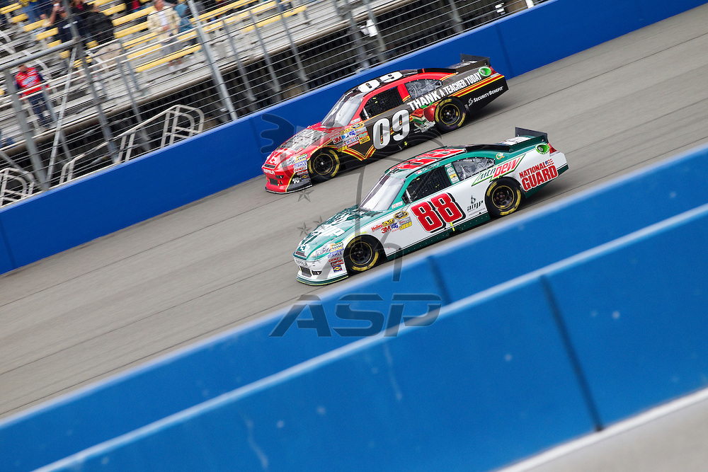 FONTANA, CA - MAR 27, 2011:  Dale Earnhardt, Jr. (88) and Landon Cassill (09) race for position down the front stretch during the Auto Club 400 race at the Auto Club Speedway in Fontana, CA.
