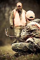 YOUNG HUNTER AND HIS DAD WITH HIS FIRST BUCK