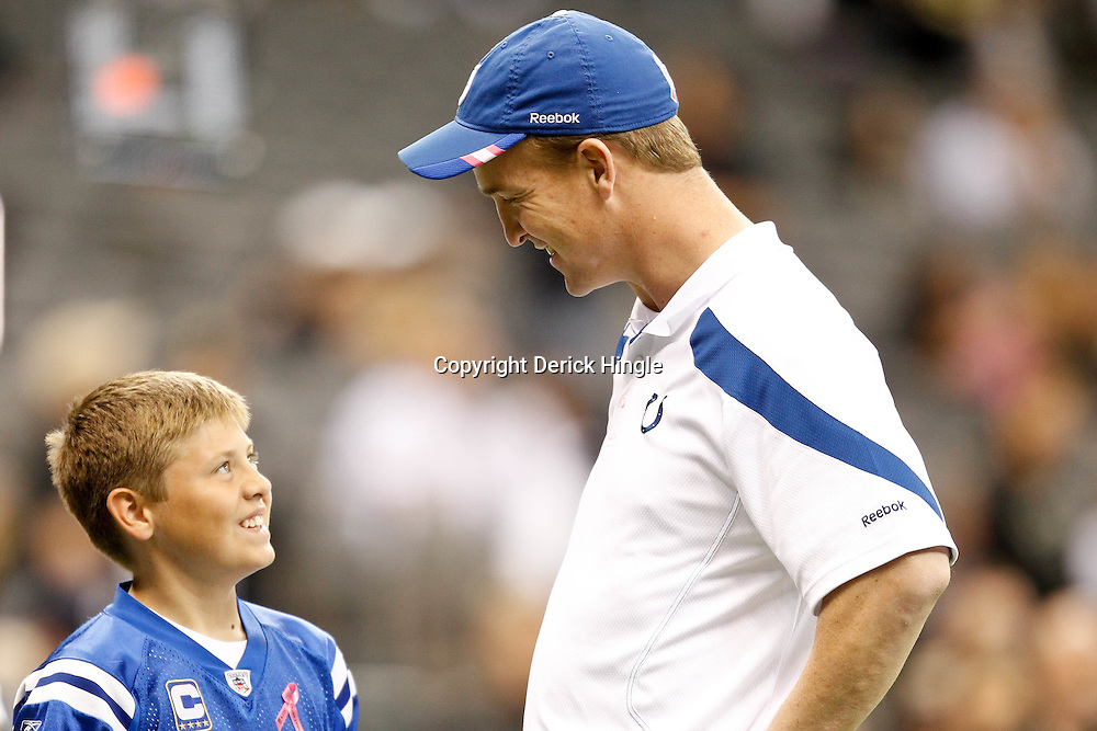 October 23, 2011; New Orleans, LA, USA; Indianapolis Colts quarterback Peyton Manning (18) talks with a young fan prior to kickoff of a game against the New Orleans Saints at the Mercedes-Benz Superdome. Mandatory Credit: Derick E. Hingle-US PRESSWIRE / © Derick E. Hingle 2011