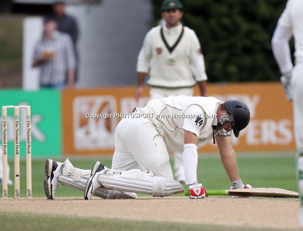 New Zealand Captain Daniel Vettori down and out on his knees after being hit hard in the back.<br />Test Match Cricket. 1st test. Day 3.<br />New Zealand Black Caps versus Australia. Basin Reserve, Wellington, New Zealand. Sunday 21 March 2010. Photo: Andrew Cornaga/PHOTOSPORT