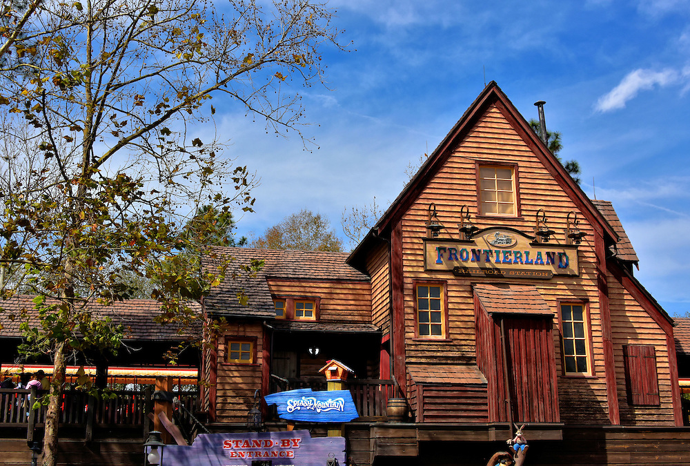 Frontierland Railroad Station at Magic Kingdom in Orlando, Florida<br /> The Walt Disney World Railroad covers a track of 1.5 miles connecting Main Street U.S.A. with Fantasyland and this station at Frontierland. The free WDWRR transportation is conducted (pun intended) by four vintage steam locomotives. These reflect Walt&rsquo;s love of trains since he built the Carolwood Pacific Railroad at his boyhood home. Frontierland has an American Old West theme. The section&rsquo;s main attractions are Splash Mountain (water ride), Country Bear Jamboree (bear manikins performing western music), Shootin&rsquo; Arcade, Tom Sawyer Island and Big Thunder Mountain Railroad (roller coaster).
