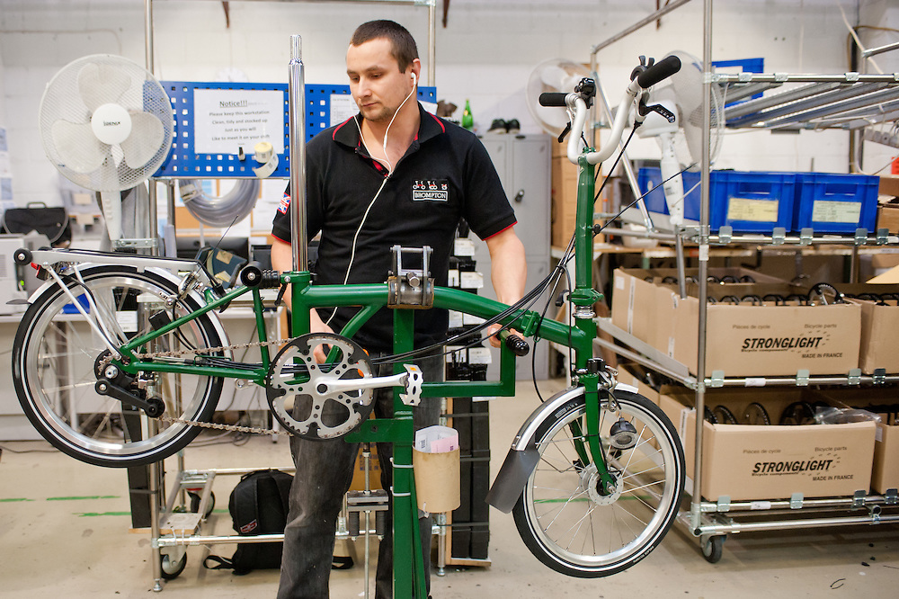 London, UK - 29 January 2013: a workman assembles components of a  folding bike in the Brompton Bicycle factory in South West London. The company was founded in 1976 by Andrew Ritchie and is one of only two major frame manufacturers still based in the UK. Today, Bromptons are sold in 42 export markets.