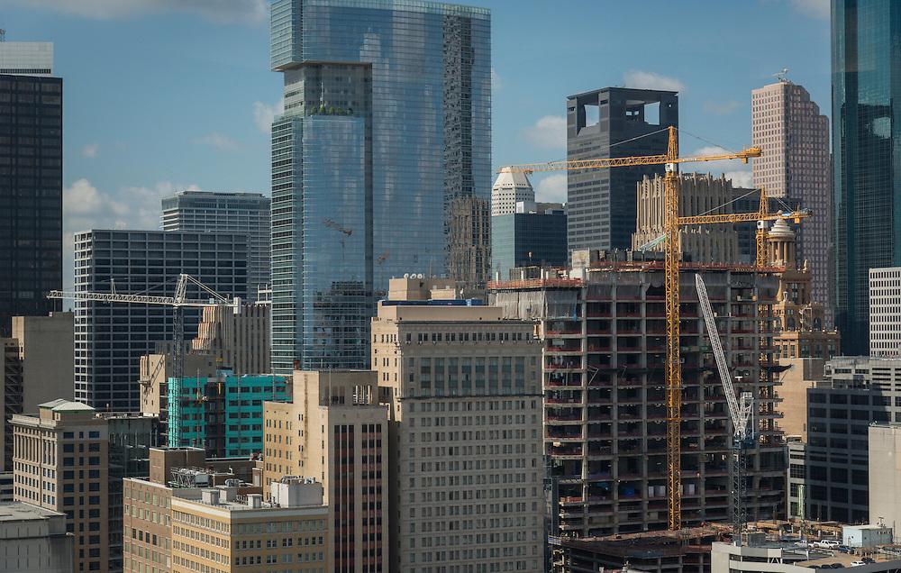 Cranes dot the Houston skyline, September 30, 2015.