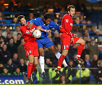 Fotball<br /> FA-cup 2005<br /> Chelsea v Birmingham<br /> 30. januar 2005<br /> Foto: Digitalsport<br /> NORWAY ONLY<br /> Chelsea's Didier Drogba getrs between Birmingham City's Matthew Upson and Stephen Clemence