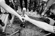 A family buries a relative, victim of Srebrenica massacre.