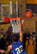 12 JAN. 2010 -- BRENTWOOD, Mo. -- Maplewood / Richmond Heights High School basketball player Calvin Belts (32) sees a dunk attempt bound off the back of the rim during the neighborhood game between Maplewood and Brentwood Tuesday, Jan. 12, 2009 at Brentwood High School in Brentwood, Mo. Photo (c) copyright 2010 by Sid Hastings.