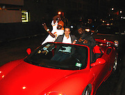 Wyclef Jean on his Ferrari with Alessandro (Ferrari's heir) and Jerry after having dinner<br />