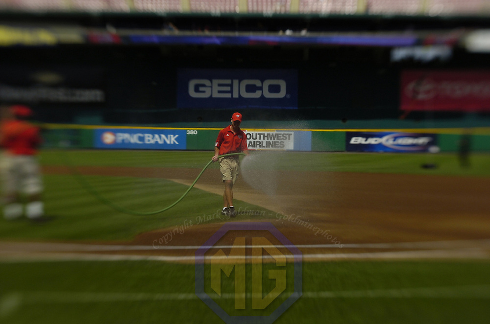 21 July 2007:  Washington Nationals heads grounds keeper Larry DeVito waters the field prior to the game between the Colorado Rockies and the Washington Nationals.  The Nationals defeated the Rockies 3-0 at RFK Stadium in Washington, D.C.  ****For Editorial Use Only****
