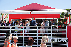 © Licensed to London News Pictures. 5/11/2013. Racegoers in a marquee in the exclusive birdcage area during Melbourne Cup Day at Flemington Racecourse on November 5, 2013 in Melbourne, Australia. Photo credit : Asanka Brendon Ratnayake/LNP