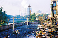 "China, Taiyuan, 2008. A cold winter morning in the rough and tumble industrial neighborhoods near ""Tai Gang,"" or Taiyuan Iron & Steel, which dominates the area."