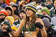 GREEN BAY, WI - DECEMBER 22:  Fan of the Green Bay Packers dances in the snow in her bathing suit during a game against the Pittsburgh Steelers at Lambeau Field on December 22, 2013 in Green Bay, Wisconsin.  (Photo by Wesley Hitt/Getty Images) *** Local Caption ***
