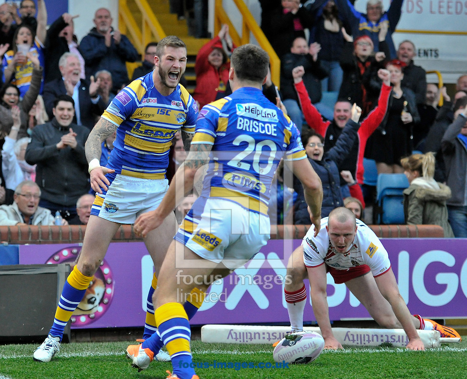 Zak Hardacker (Facing) of Leeds Rhinos dives over to score and celebrates with Tom Briscoe during the First Utility Super League match at Headingley Carnegie Stadium, Leeds<br /> Picture by Richard Land/Focus Images Ltd +44 7713 507003<br /> 02/05/2014