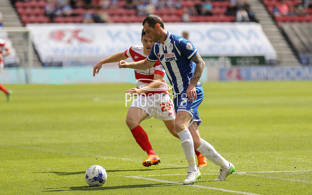 McCann & Middleton during the Sky Bet League 1 match between Wigan Athletic and Doncaster Rovers at the DW Stadium, Wigan, England on 16 August 2015. Photo by Simon Davies.