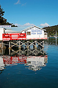 water reflections of mangonui fish shop in mangonui harbour, doubtless bay, northland, new zealand