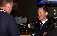 Kettering Council Candidate Nolan Thomas (right) during an election night party at Buffalo Wild Wings in the Town & Country Shopping Center in Kettering, Tuesday, November 8, 2011..