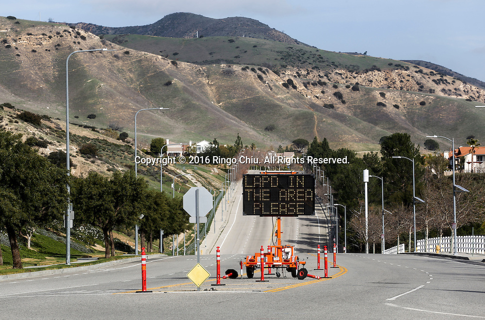 A warning sign that reads 'LAPD IN THE AREA PLEASE'  is posted near the Southern California Gas Company, Aliso Canyon storage facility at the Porter Ranch area.(Photo by Ringo Chiu/PHOTOFORMULA.com)<br /> <br /> Usage Notes: This content is intended for editorial use only. For other uses, additional clearances may be required.