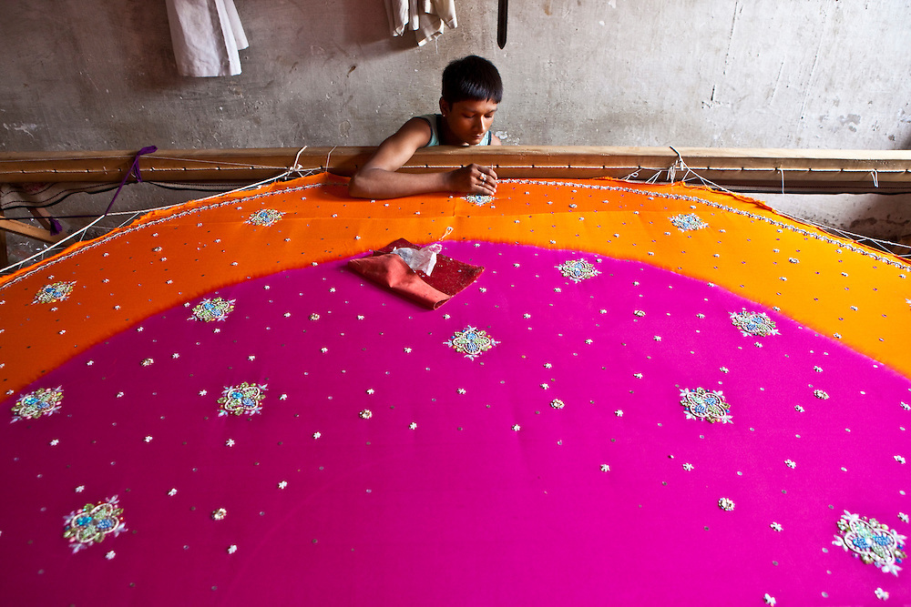 A young boy embroiders a sari in Bhavnagar, Gujarati State. The girls and boys earn 300 rupees a day. The Shaishav Trust is trying to provide education and support for children in child labour.