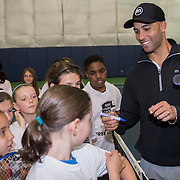 May 15, 2014, New Haven, Connecticut:<br /> Former professional tennis player James Blake signs autographs during a free tennis lesson and clinic Thursday, May 15, 2014 in advance of the 2014 New Haven Open at the Yale University Tennis Center in New Haven, Connecticut. <br /> (Photo by Billie Weiss/New Haven Open)