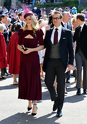 Gabriel Macht and wife Jacinda Barrett arrive at St George's Chapel at Windsor Castle for the wedding of Meghan Markle and Prince Harry.