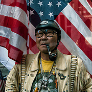 Korean American biker, showing both his culture and and ethnic pride and well as pride of being an American in the  Annual Korean Harvest Parade in New York City. <br />