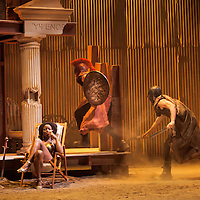 Ben Dilloway (red head dress) and Reuben Johnson with Emanuella Cole. <br /> <br /> The Iliad<br /> <br /> By Chris Hannan<br /> Directed by Lyceum Artistic Director Mark Thomson<br /> <br />  20 April &ndash; 14 May 2016<br /> <br />  The Gods of Olympus take their sides and the fates of all men hang in the balance.<br /> Homer's Iliad, the greatest and most influential epic poem ever written, tells of the tragic and bloody climax to the ten-year siege of Troy; the darkest episode in the Trojan War.<br /> <br /> This great tale of gods and heroes, love, jealousy and revenge is brought to visceral life in a brand new adaptation by award winning Scottish Playwright Chris Hannan (Crime and Punishment, Elizabeth Gordon Quinn, Shining Souls).<br /> <br />  Lyceum.org.uk/iliad | #ILIAD<br />  <br /> CAST<br /> <br /> Jennifer Black<br /> Peter Bray<br /> Emanuella Cole<br /> Richard Conlon<br /> Amiera Darwish<br /> Ben Dilloway<br /> Ron Donachie<br /> Melody Grove<br /> Mark Holgate<br /> Reuben Johnson<br /> Daniel Poyser<br /> Ben Turner<br /> <br />  <br /> CREATIVE TEAM<br /> <br /> Mark Thomson, Director<br /> Chris Hannan, Writer<br /> Karen Tennent, Set Designer<br /> Simon Wilkinson, Lighting Designer<br /> Megan Baker, Costume Designer<br /> Claire McKenzie, Composer<br /> Raymond Short, Fight Director<br /> Laura Cameron-Lewis, Assistant Director<br /> <br />  <br /> Supported by <br /> Claire &amp; Mark Urquhart<br /> <br /> Additional support from<br /> Dr David McNeil Summers Charitable Trust<br /> <br /> <br /> Picture by Drew Farrell<br /> Tel : 07721-735041<br /> www.drewfarrell.com<br /> Note to Editors :<br /> This image is free to use in the promotion of The Lycuem and their partners. Please check for all other uses as a fee may apply.