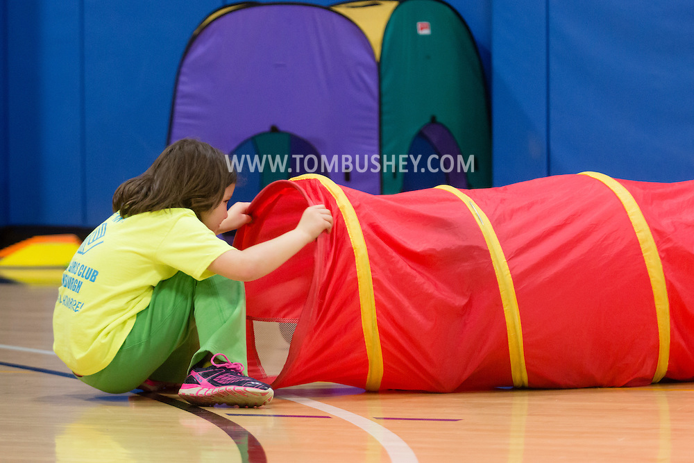 Newburgh, New York - A young girl plays with a tube during  the YMCA's  Family Night at the Newburgh Armory Unity Center  on March 27, 2015.