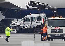 © Licensed to London News Pictures. 14/02/2018. London, UK. Police remove a damaged British Airways vehicle from the tarmac at Heathrow Airport after this morning's fatal crash near Terminal 5. Photo credit: Peter Macdiarmid/LNP