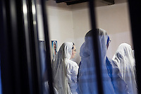 ROME, ITALY - 27 AUGUST 2016: A Sister of the Missionaries of Charity, the religious congregation founded by Mother Teresa in 1950, listens to the morning mass at the Mother House in Rome, Italy, on August 27th 2016.<br /> <br /> Mother Teresa, also known as Blessed Teresa of Calcutta, was an Albanian Roman Catholic nun and missionary. She founded the Missionaries of Charity, a Roman Catholic religious congregation, whose members must adhere to the vows of chastity, poverty, and obedience, as well as the vow to give wholehearted free service to the poorest of the poor. Shortly after she died in 1997, Pope John Paul II waived the usual five-year waiting period and allowed the opening of the process to declare her sainthood. She was beatified in 2003. A second miracle was credited to her intercession by Pope Francis, in December 2015, paving the way for her to be recognised as a saint by the Roman Catholic Church. Her canonisation is scheduled for September 4th 2016, a day before the 19th anniversary of her death.